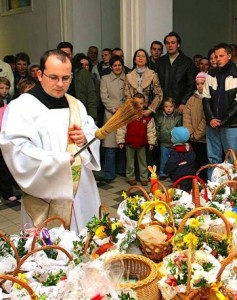 Catholic-deacon-blesses-Easter-Baskets-on-Swięcone-in-Poland